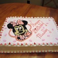 Little Minnie   French Vanilla Cake with Strawberry filling. All buttercream icing - Minnie is done by hand on top of cake.