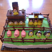 Farmville Cake   buttercream frosting, chocolate dipped pretzel fence, hershey and graham cracker buildings and fondant animals