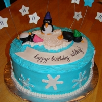 Winter Wonderland Buttercream cake with fondant penguins, fondant snowflakes and gum paste stars on wire.