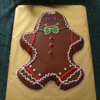 Gingerbread Man Cake Vanilla marbled cake with chocolate bc frosting. All bc and plain chocolate coated candies decorations.