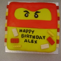 Ninjago Chocolate cake covered in fondant with Lego block candy melts.