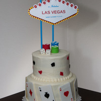 Las Vegas Engagement Party Cake was for a couple getting married in Las Vegas. Everything is edible, except for the Las Vegas sign.