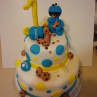 Baby C. Monster Cake all edible cake. figure, cookies, milk bottle, cookie jar and #1 are all made out of fondant.