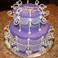 Swirly Sweet Birthday Royal Icing swirls and drop flowers with BC piping lattice work and drop strings. BC icing over a vanilla cake torted with caramel filling...
