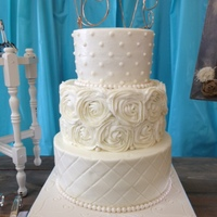 Rustic Country 6,8,10 inch buttercream. Fondant rose pearl borders. Buttercream rosettes.