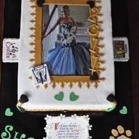 High School Gradutaion double layer 9x13. Buttercream with fondant accents. Edible images. School colors are: gold,white, black, & green. Lion is the mascot...
