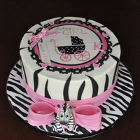 Zebra Stripes 10' round buttercream with fondant accents. Edible image.