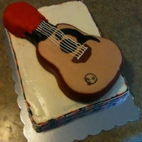 "Maker's Mark Dipped Guitar   Two of the groom's favorites! Maker's and music. Maker's ""wax"" 50/50 fondant and candy clay."
