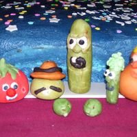 Veggie Tales Cast In Candy Clay  Veggie tales made of modeling chocolate for my grandsons cake. My first figures ever... what an adventure! The holes on some of them are...