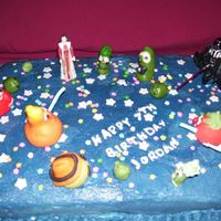 Star Wars & Veggie Tales  Strawberry and triple fudge wasc marbled, buttercream icing. Stars and light sabers are gumpaste, veggie tales made of candy clay. Only my...