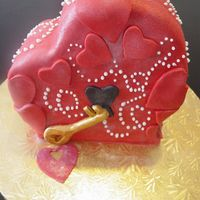 Valentine Sculpted Heart Cake This is a vanilla cake with strawberry filling. I made this cake for a client who wanted to tell her boyfriend he is the key to her heart....