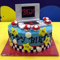 Nintendo Ds Mario Kart Birthday Cake For Ben's 8th Birthday. Chocolate cake with vanilla smbc and ganache filling.All decorations, including the Nintendo DS, are handmade...