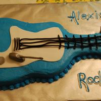Guitar Cake ok - so it looks like a ukelele; i used the wilton guitar pan and attempted the shortcut of black licorice lacing for strings. i did not...