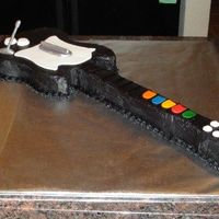 Guitar Hero guitar hero cake, carved from template traced from controller; all buttercream - chocolate tinted wtih tubed wilto black fronsting - tasted...