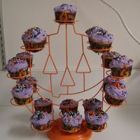 Halloween Cupcakes orange flavored cupcakes, holiday hallowee cupcake wrappers, purple frosting, halloween sprinkles on wilton halloween pumpkin cupcake stand...