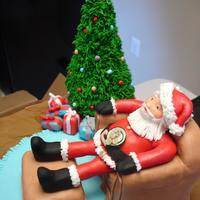 Christmas In Sugar this is a Christmas cake made to look like Santa Clause is sitting in your living room eating cookies and relaxing on your chair. with...