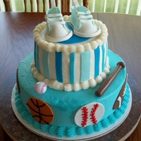 Sports Themed Baby Shower Cake 10 inch and 6 inch cakes with buttercream frosting and fondant/gumpaste accents shoes were made using pattern from here on CC. Made of...