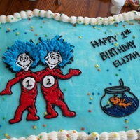 Thing 1 And Thing 2 Birthday Cake Transfered frozen buttercream outline and filled in with cookie glaze to achieve shiny efffect. Cupcake cake