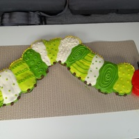"The Hungry Little Caterpillar Copied this from an awesome cake site called ""My Cake School .com"" Very fun to make body is cupcakes and head is 4 inch cake"