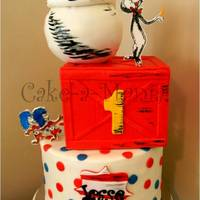 Cake-A-Mania 2013 Dr. Seuss and Thing 1 Thing 2. 3 tier with edible hand drawn characters. Fun cake for sure.