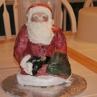 Santa This is a pan that I bought at Williams-Sonoma after Christmas last year. I was playing with fondant when I did this cake. I have never...
