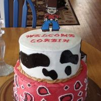 Rodeo Baby Shower Cake Cowboy is made from a chocolate transfer and cow spots and rope are mmf