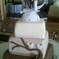 Varying Shades Of Brown. the bride designed this cake and the groom chose the topper!