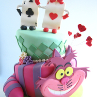 Alice In Wonderland Wedding Cake I made this wedding cake for a couple who adored the cheshire cat! I really had a lot of fun making this cake. Got a lot of ideas from the...