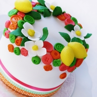 Spring Cake   It was so fun to make this small 5 inch cake with exploding colors, buttons and lemons.Easter cake, or spring theme.