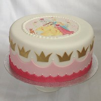 "Disney Princess Cake 8"" cake with edible print on top and golden crowns. Also glitter, but picture doesn't show!"
