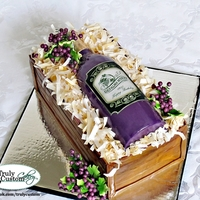 Wine Bottle Cake Wine bottle cake. All Edible except wires that the grapes are on. Bottle is cake. Shredded paper in wine box is rice paper that I cut,...