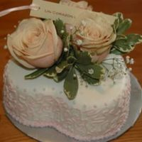 A Heart Full Of Love... Heart shaped cake with MMF and Cornelli lace with fresh roses on top.