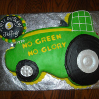 Race Tractor White cake covered in fondant. Had headlights that actually worked. Extra tire was rice crispie treat.