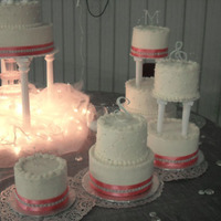 Fountain Wedding White almond sour cream cakes with pink ribbons. Wilton Fountain.