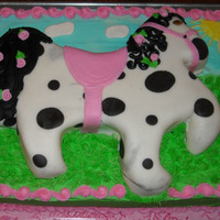 Horsey Buttercream sheet cake with another cake on top that is covered in fondant.