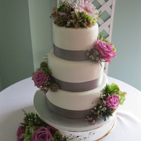 3 Tiers Covered In Fondant With Fresh Flowers