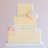 Yellow Quatrefoil And Pink Hydrangeas Fondant covered cake with yellow quatrefoil (using custom cutters) and pink hydrangea.