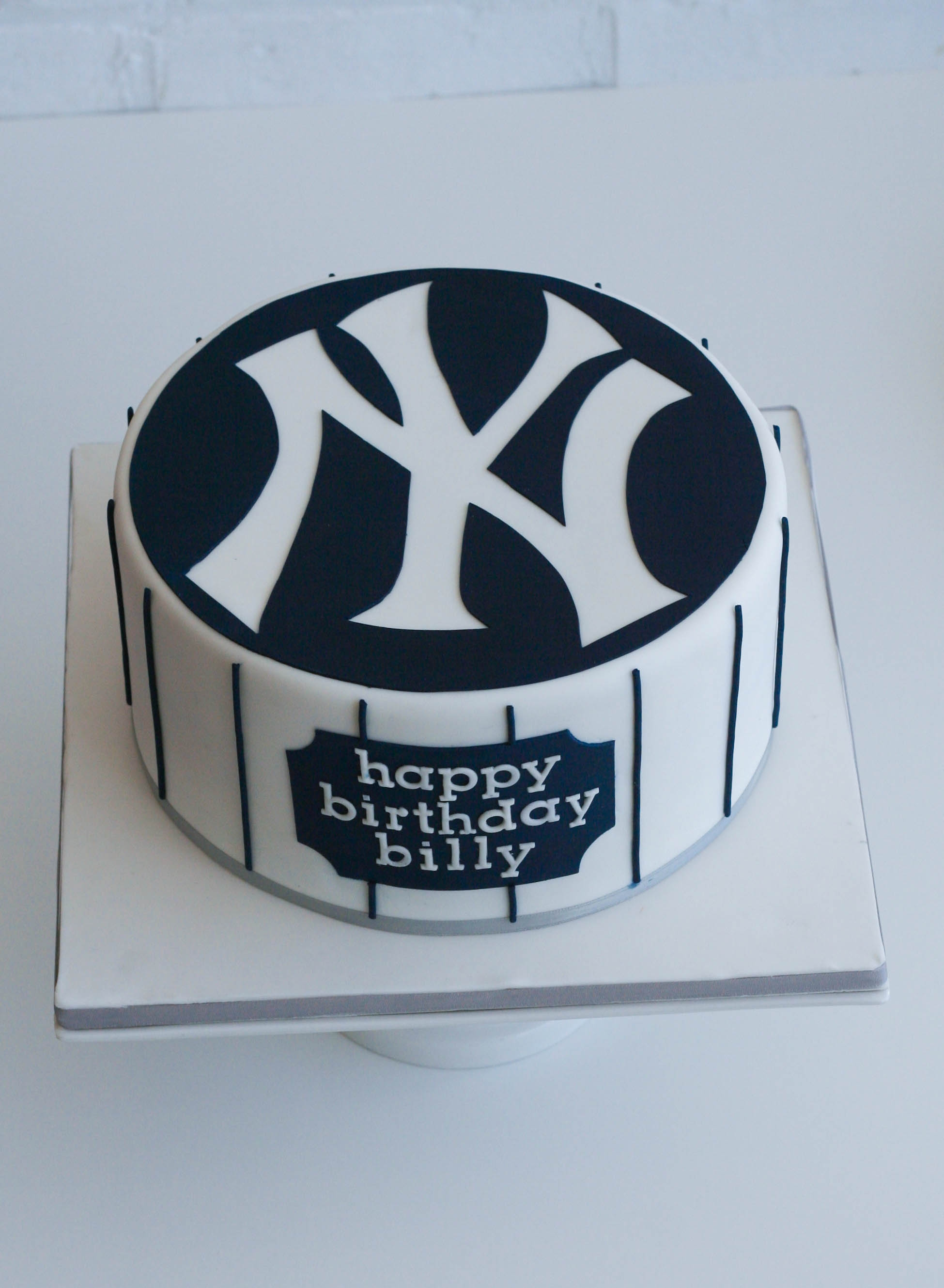 "New York Yankees Birthday Cake Single-tier 8"" cake (chocolate cake with Bailey's French buttercream). New York Yankees logo hand cut in the negative out of blue..."