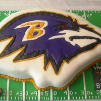 Baltimore Ravens Cake covered in white fondant, Ravens logo made with color flow technique.