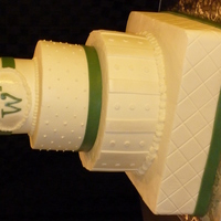 Mixed Shape Wedding Cake Buttercream icing with fondant ribbon and accents. TFL.