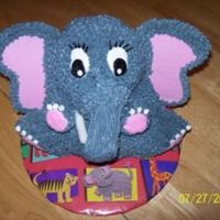 Elephant 3-D cake i made from the cuddly bear stand up pan. He does have another tusk, it's just hidden. ; ) My son loved this cake and still...