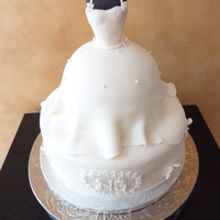 "Bridal Shower Cake Of Bridal Gown On Mannequin My sister's bridal shower cake covered in fondant. The base is a 10"" cake and the bridal gown was made with a 6"" round and a..."