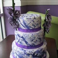 Swirled Cake With Flowers This is a cake I did last weekend based off of the picture in the magazine I posted earlier. Its fondant with purple painted swirl.
