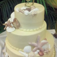 "Seashells 6"", 9"", 12"" round...offset, buttercream with chocolate and fondant seashells."
