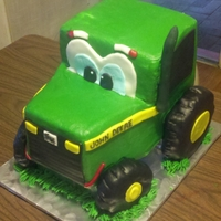 Johnnie Deere Johnnie Deere inpired cake, buttercream iced with some fondant and gumpaste add-ons, tires are RKT covered in fondant