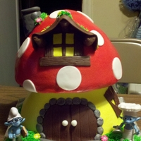 Smurf House Two wonder mold cakes stacked. Buttercream iced with fondant details. The figurines are toys! TFL