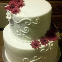 "Wedding 9"" base, 6"" topper....buttercream flat iced with piped decorations and gumpaste gerber daisies."