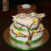 Yellow Blossom Tree Fondant covered cakes with gumpaste flowers, banner, tree, and nest.