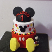 Rubens First Birthday strawberry cake,iced in buttercream. gumpaste mickey,rkt hat and feet. inspired by mickey mouse cakes made by cc members.