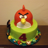 Jr's Angry Bird Birthday strawberry cake with strawberry filling,iced in buttercream.the red angry bird is also cake,but covered in fondant. the angry birds and the...